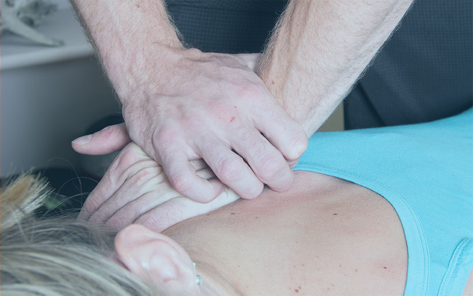 Chiropractor Treating Patient Shoulder Pressure