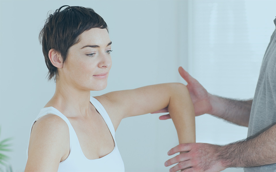 Chiropractor Working On A Womans Arm