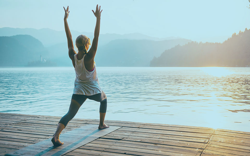 Woman Practicing Sun Salutation Yoga