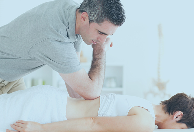 Woman Relaxing During A Back Massage